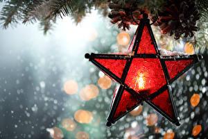 Fotos Feiertage Neujahr Kerzen Großansicht Ast Stern-Dekoration