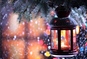 Bilder Feiertage Neujahr Kerzen Ast Laterne