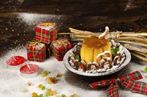 Fotos Neujahr Kekse Kerzen Süßigkeiten Gelee Puderzucker Geschenke Schleife