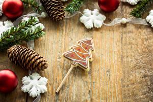 Fotos Neujahr Bretter Ast Zapfen Kugeln Schneeflocken Tannenbaum Lebensmittel