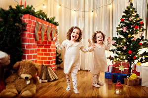 Desktop wallpapers Christmas Holidays Teddy bear Little girls 2 New Year tree Present Fireplace Laughter Joyful child