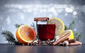 Bilder Neujahr Getränke Zimt Zitrusfrüchte Zitrone Orange Frucht Trinkglas Ast Lebensmittel