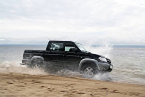 Wallpapers Coast Russian cars UAZ Black Moving patriot off-road 4x4 auto