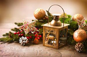 Bilder Neujahr Kerzen Ast Kugeln Stern-Dekoration Zapfen Laterne