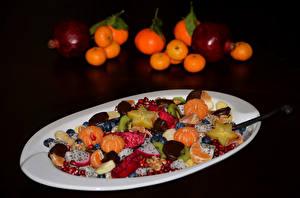 Images Mandarine Salads Pomegranate Fruit Black background Plate Food