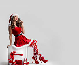Images Christmas White background Brown haired Winter hat Uniform Legs High heels Knee highs Gifts Girls