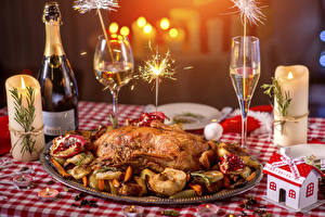Pictures Christmas Holidays Table appointments Roast Chicken Champagne Candles Stemware Bottle Sparkler Food