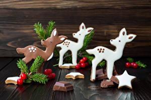 Hintergrundbilder Neujahr Schokolade Hirsche Ast Stern-Dekoration Lebensmittel