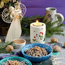 Bilder Neujahr Feiertage Engeln Kerzen Süßigkeiten Nussfrüchte Brei Ast Russian Christmas Lebensmittel
