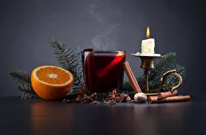 Fotos Neujahr Kerzen Apfelsine Sternanis Zimt Getränke Ast Trinkglas Lebensmittel
