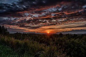 Pictures Alaska Sunrises and sunsets Sky Evening Scenery Clouds Grass Sun Wasilla Nature