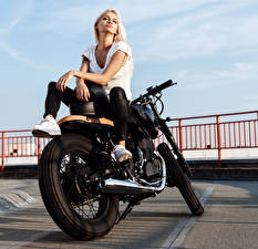 Picture Blonde girl Motorcyclist Hands Sitting young woman Motorcycles