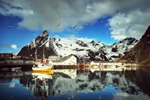 Pictures Norway Lofoten Mountains Houses Pier Gull Speedboat Clouds Reine Cities
