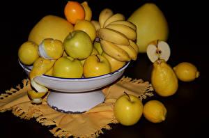 Bilder Obst Bananen Äpfel Zitrone Schwarzer Hintergrund Lebensmittel