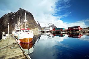 Bilder Lofoten Norwegen See Seebrücke Motorboot Felsen Spiegelt Natur