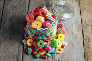 Pictures Candy Sweets Marmalade Wood planks Jar Sweet Jelly Candies Food