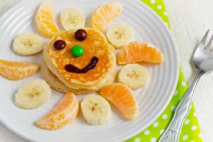 Fonds d'écran Créatif Smilies Pancake Fruits Confiseries Orange fruit Bananes Assiette Nourriture