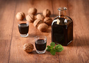 Photo Drinks Nuts Wood planks Bottle Shot glass Two Food