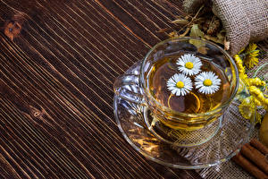 Bilder Getränk Tee Kamillen Bretter Tasse Untertasse Lebensmittel