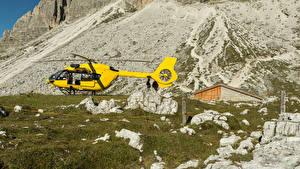 Bilder Hubschrauber Steine Gelb Luftfahrt