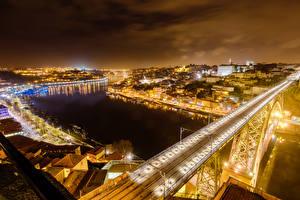 Tapety na pulpit Portugalia Domy Rzeki Mosty Porto W nocy Miasta