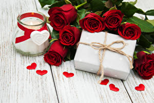 Pictures Roses Candles Wood planks Dark red Jar Gifts Heart Flowers