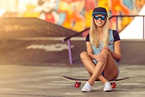 Wallpaper Skateboard Blonde girl Smile Glasses Baseball cap Sitting Legs young woman