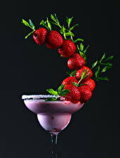 Pictures Cocktail Strawberry Black background Design Food