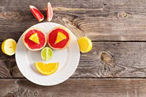 Fonds d'écran Pamplemousse Citrons Smilies Assiette Madrier Nourriture