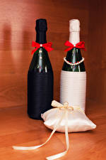 Wallpapers Holidays Sparkling wine Noces Bottle 2 Pillows Ring Bowknot Food