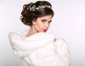 Pictures Jewelry Brown haired Fur coat Staring White background Beautiful young woman