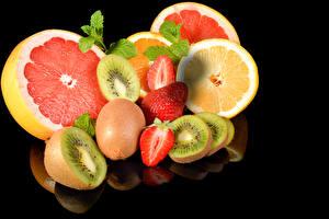 Image Chinese gooseberry Orange fruit Strawberry Grapefruit Fruit Black background Food