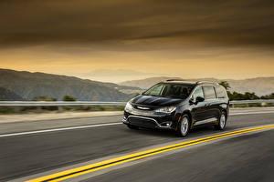 Image Chrysler Black Metallic Driving 2017 Pacifica Touring-L Plus