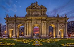 Wallpaper Madrid Spain Houses Evening Lawn Street lights Arch Puerta de Alcala Cities