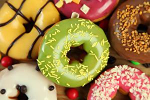 Фотографии Выпечка Пончики Крупным планом Сахарная глазурь Продукты питания