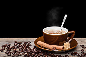 Wallpapers Drinks Coffee Cinnamon Black background Cup Grain Food