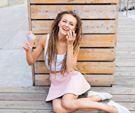Pictures Ice cream Locs Boards Brown haired Smile Sit Skirt young woman