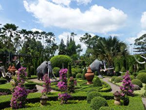 Hintergrundbilder Thailand Garten Skulpturen Mammute Design Strauch Palmen Nong Nooch Tropical Botanical Garden Natur