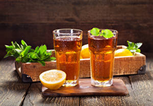 Photo Drinks Lemons Lemonade Boards Cutting board Highball glass Two Food