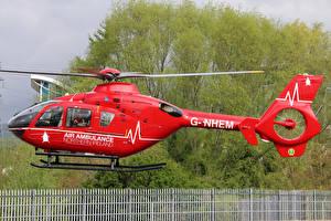 Bilder Hubschrauber Rot Seitlich Flug G-NHEM Eurocopter EC-135-T2 Luftfahrt