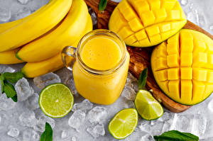 Bilder Mango Fruchtsaft Bananen Limette Becher Eis Gelb