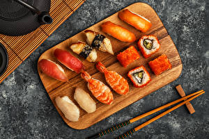 Photo Seafoods Sushi Fish Cutting board From above Chopsticks Food