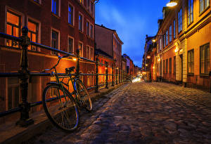 Pictures Stockholm Sweden Houses Street Night time Bicycle Fence Street lights Cities