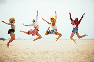 Pictures Beach Jump Legs Four 4 Girls