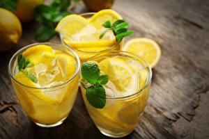 Fotos Getränke Zitrone Limonade Trinkglas Blattwerk Minzen das Essen