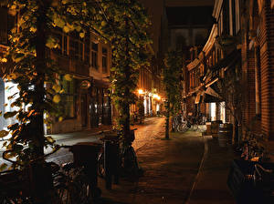 Images Netherlands Houses Street Night time Street lights Bike Haarlem Cities