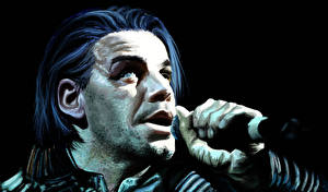 Pictures RAMMSTEIN Man Black background German Head Mic Till Lindemann