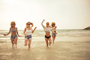 Photo Sea Water Blonde girl Smile Glasses Water splash Shorts Run young woman