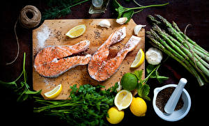Pictures Seafoods Fish - Food Lemons Vegetables Allium sativum Seasoning Cutting board Food