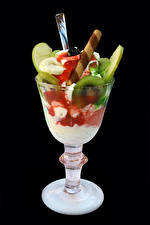 Photo Sweets Ice cream Fruit Black background Stemware Food
